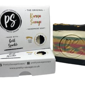 A black and white soap with red, gold and green